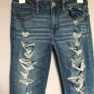 Light blue jeans with holes